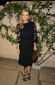 Style star Diane Kruger added sizzle to her '40s inspired look with a pair of black suede double crisscross sandals at Miu Miu's 'Muta' presentation.