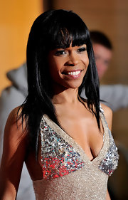 Michelle was all smiles on the red carpet while showing off her bunt cur bangs and straight tresses. The R & B singer finished her look off with a complementary shade of metallic eyeshadow.
