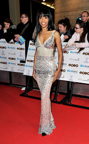Michelle showed off her slender figure in a sequin embellished evening gown.