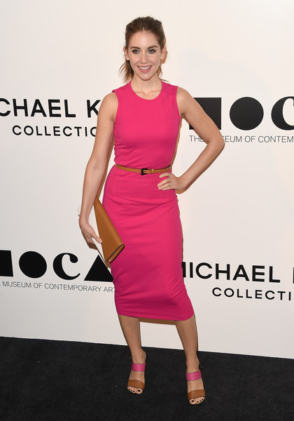 Alison Brie completed her perfectly coordinated attire with a two-tone leather clutch.