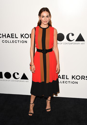 Camilla Belle went for minimal styling with a pair of black ankle-strap sandals, also by Michael Kors.
