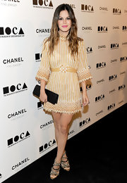 Rachel Bilson dazzles in chain trimmed sandals by Camilla Skovgaard. The strappy heels look stunning paired with Rachel's Chanel frock.