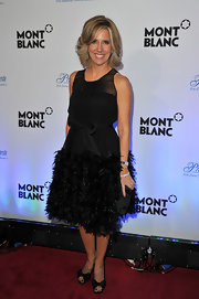 Alysyn Camerota wore an opulent feathered chiffon cocktail dress with a bowed waist for the Princess Grace Awards red carpet.
