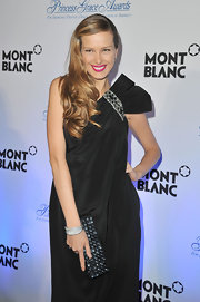 Petra Nemcova upped the glitz of her dazzling evening attire with a sparkly black gemstone clutch.