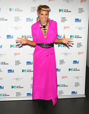 Ashley Hart made a trenchcoat a long dress by wearing layered leather belt.