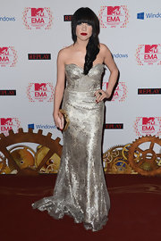 Carly Rae Jepsen looked Victorian with a twist in this metallic brocade gown and rich red lips.