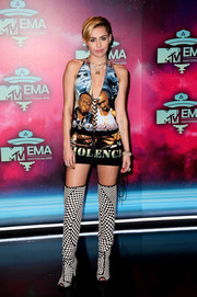 Miley Cyrus kept it bold all the way down to her Tom Ford checkered boots.