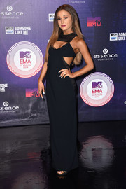 Ariana Grande went for a more mature look with this black Cristiano Burani cutout gown at the MTV EMAs.