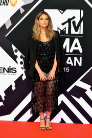 Ashley Benson made a chic appearance at the MTV EMAs in a beaded sheer dress by Haney teamed with a black boyfriend blazer by BCBG Max Azria.