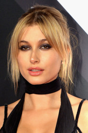 Hailey Baldwin completed her alluring look with a smoky eye.