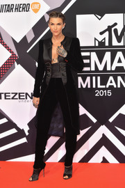 Ruby Rose looked totally rocker-glam at the MTV EMAs in a black Armani Privé satin and velvet coat teamed with matching pants.