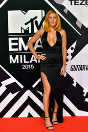 Ellie Goulding styled her sexy dress with whimsical angel-wing sandals by Sophia Webster.