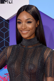 Jourdan Dunn wore nude lipstick to balance out her smoky eye.
