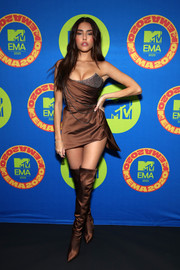 Madison Beer paired her sexy dress with coordinating over-the-knee satin boots.