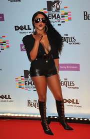 Lik' Kim paired her leather hotpants with knee-high, corseted boots.