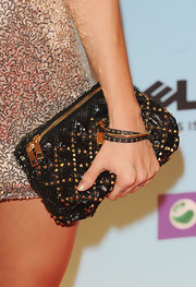 Medina added a rockstar element to her outfit by carrying a studded clutch at the MTV Awards.