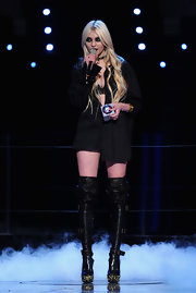 Taylor Momsen's lack of pants certainly draws attention to her extraordinary Alexander McQueen Fall 2010 Mock-Croc Buckle Over the Knee Boots. ]