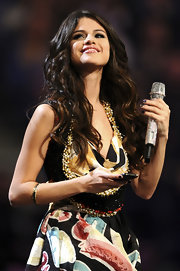 Selena Gomez wore golden shadow and jet crystal Powder bangles at the 2011 MTV Europe Music Awards.