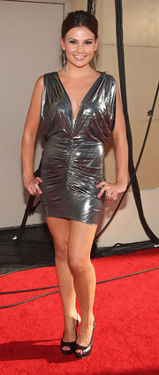 Stacie kept it sexy in a metallic mini dress with a plunging neckline.