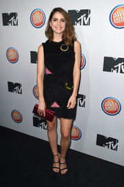 Shelley Hennig completed her outfit with sexy triple-strap heels.