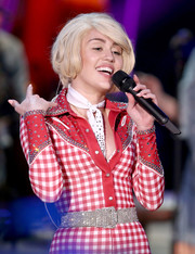 Miley Cyrus dazzled up her gingham jumpsuit with a crystal belt for her 'MTV Unplugged' performance.