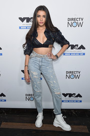 Madison Beer completed her outfit with a pair of distressed boyfriend jeans.