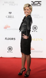 Helene Fischer showed off her curves in a figure-hugging ruched black skirt at the Musik Hilft charity dinner.