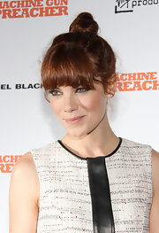 Michelle Monaghan wore her auburn locks pulled up into a top knot for the 'Machine Gun Preacher' premiere. Her fun look is easy to duplicate by pulling hair up into a ponytail on the very top of the head. Then, tightly twist the ponytail and wrap, tucking ends into the hair elastic.