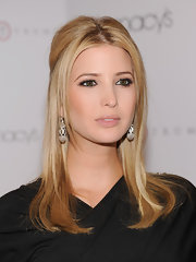 Ivanka Trump wore her straight locks in a half up hairstyle at the launch of her footwear collection at Macy's. Face framing center part bangs completed her look.