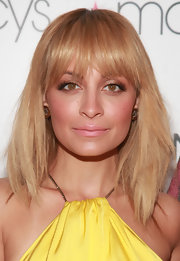 Nicole Richie swept on a pale pink-beige lipstick for Macy's Fashion Star celebration.