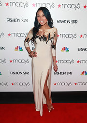 Jeannie Mai accessorized her evening gown with metallic platform pumps.