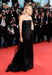 Naomi Watts was a classic beauty in a black lace strapless gown by Ralph Lauren during the 'Mad Max: Fury Road' premiere in Cannes.