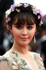 Fan Bingbing cut a hyperromantic figure at the 'Mad Max: Fury Road' premiere with this voluminous crown braid adorned all over with flowers.