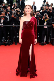Julianne Moore was all about edgy glamour at the 'Mad Max: Fury Road' premiere in a red Givenchy Couture velvet one-shoulder gown with a croc-embossed bodice underlay and a thigh-baring slit.