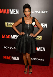Tamron Hall was equal parts girly and edgy in a fit-and-flare, zip-front LBD during the 'Mad Men' special screening.