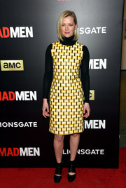 Gretchen Mol got majorly retro in a yellow print dress layered over a black turtleneck at the 'Mad Men' special screening.