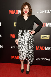 Vanessa Bayer chose an asymmetrical print skirt to team with her shirt.