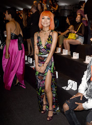Jhene Aiko went playful and sexy in a Moschino neon-print wrap dress with a plunging neckline and a high slit during the label's fashion show.