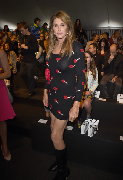 Caitlyn Jenner looked foxy in a body-con lip-print mini dress by Moschino during the label's fashion show.