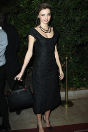 Miranda Kerr looked downright elegant at the 'Mademoiselle C' cocktail party in a textured little black dress with a low neckline and cap sleeves.