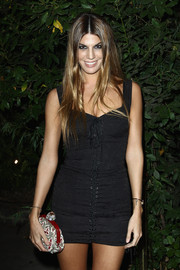 Bianca Brandolini showed off her figure in a tight-fitting black mini dress during the 'Mademoiselle C' cocktail party.