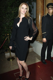 Lara Stone exuded timeless elegance in a little black dress with a deep-V neckline and sheer sleeves during the 'Mademoiselle C' cocktail party.