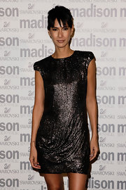 Lindy sparkled in a fabulous sequined, padded-shoulder mini dress.