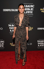 Emmanuelle Chriqui paired her chic dress with black multi-strap heels.