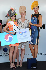 Laura Dundovic looked svelte in a print sheath with peekaboo detailing at the Magic Millions Raceday.