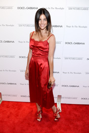 Julia Restoin-Roitfeld amped up the sweetness with a pair of bow-adorned red T-strap sandals.