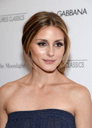 Olivia Palermo attended the 'Magic in the Moonlight' premiere wearing her hair in a lovely loose ponytail.