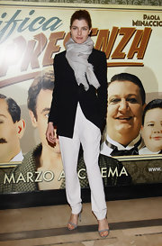 Vittoria Puccini went for a bold monochrome look at the Milan premiere of 'Magnifica Presenza', pairing her classic black blazer with crisp white pants and a gray scarf.