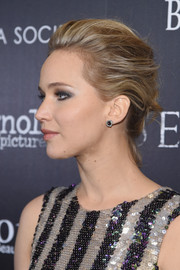 Jennifer Lawrence brushed her hair back into a sophisticated loose bun for the screening of 'Serena.'