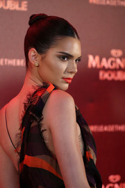 Kendall Jenner styled her hair into a tight, twisted bun for the Magnum Doubles Party.